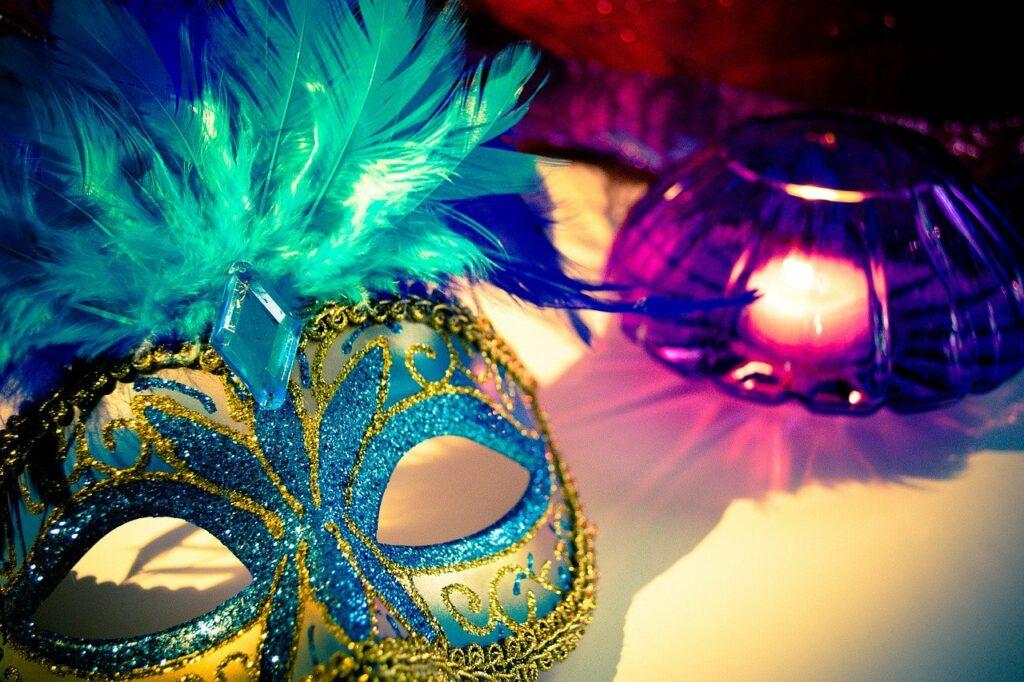 venetian mask, candle, feathers